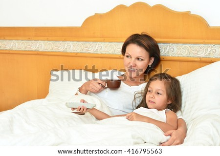 mother  with little daughter and coffee