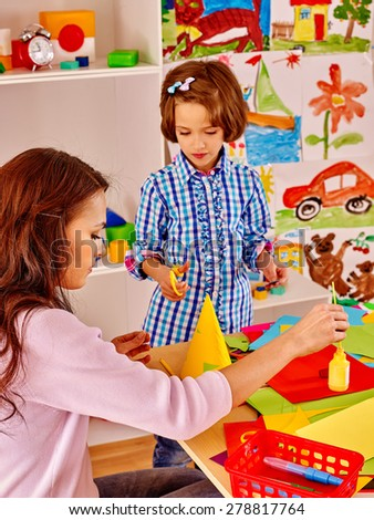 Mother with little girl kid  painting  child picture in school.  - stock photo