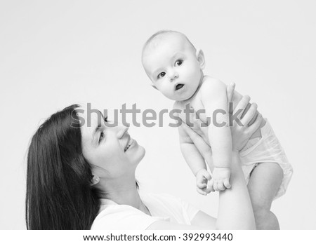 Mother with new baby born portrait studio black and white - stock photo