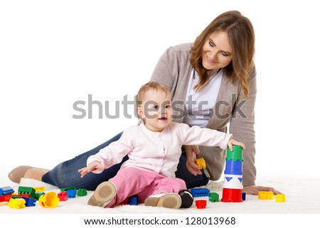 Mother with small baby play on a white background.