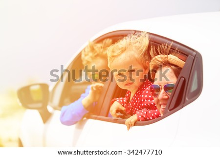mother with son and daughter travel by car, family travel - stock photo