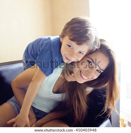 mother with son, happy family at home, smiling - stock photo