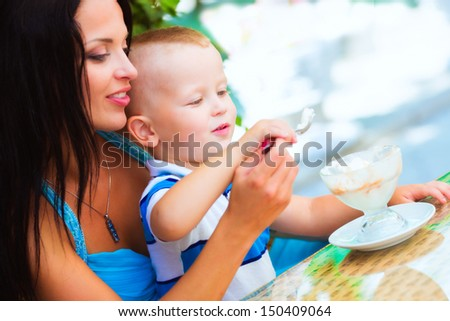 Mother with son in cafe