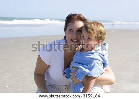 Mother with son on a beach