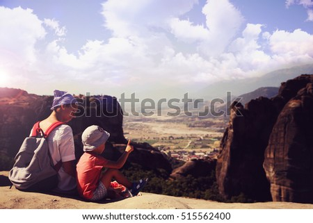 Mother with son on mountain