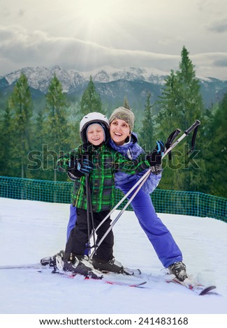 Mother with son on the mountain sky resort - stock photo