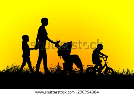 Mother with stroller and children walking at sunset.