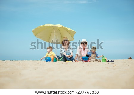 mother with the boys on the beach
