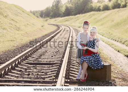 Mother with the daughter go on rails - stock photo