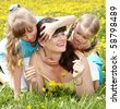 Mother with two children in outdoor. - stock photo