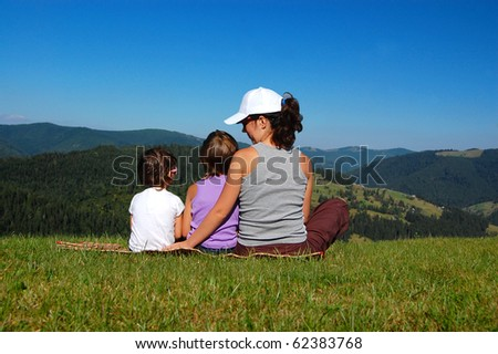 Mother with two kids looking at the beautiful view