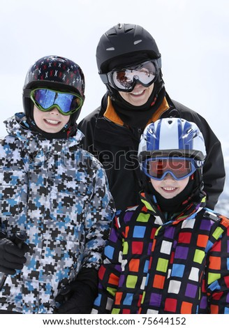 mother with two young boys skiing - stock photo