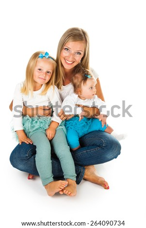 Mother with two young daughters - stock photo