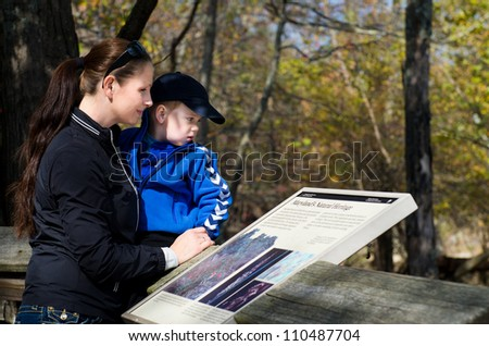 Mother with 3 year old son on a family trip - stock photo