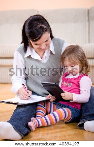 mother working at home - stock photo