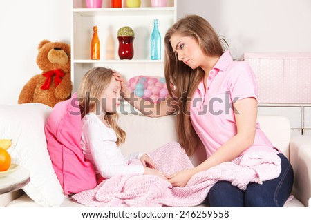 Mother worried about child's fever - stock photo