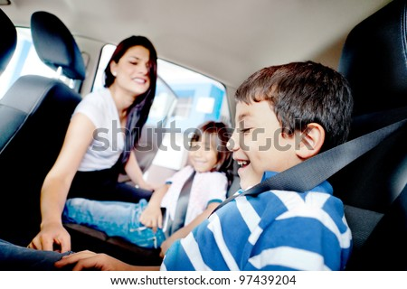 Mother worried about her children's safety in a car - stock photo