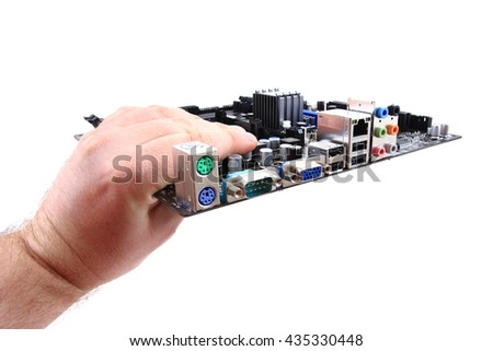 motherboard in human hand isolated on the white background - stock photo