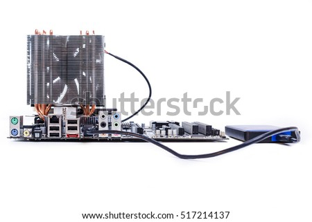 motherboard with CPU and cooler and external hard drive on white background