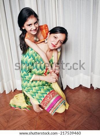 Motherhood - Sharing love. - stock photo