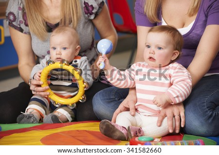 Mothers And Babies At Music Group - stock photo