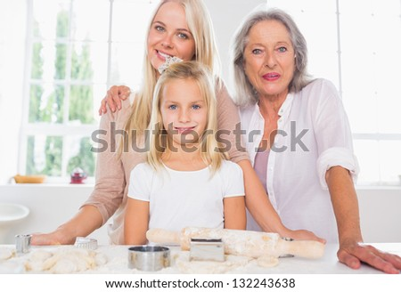 Mothers and daughters cooking together in the kitchen - stock photo