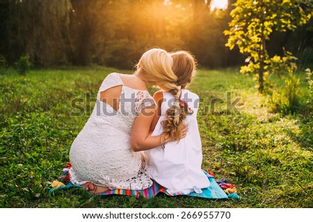 mothers and daughters hair braided as one plait - stock photo