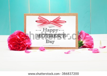 Mothers day card with pink carnations over teal wooden wall - stock photo