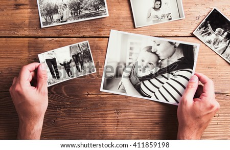 Mothers day composition. Black-and-white pictures, wooden backgr - stock photo