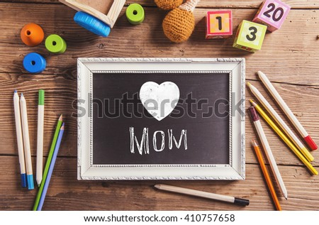 Mothers day composition, various toys. Picture frame, studio sho - stock photo