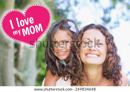 mothers day greeting against happy mother and daughter embracing - stock photo