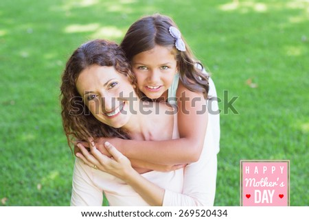 mothers day greeting against happy mother and daughter smiling at camera - stock photo