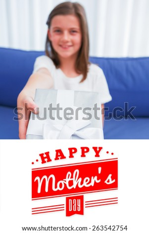mothers day greeting against little girl offering a silver gift - stock photo