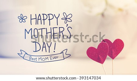 Mothers Day message with small red hearts with white dishes - stock photo