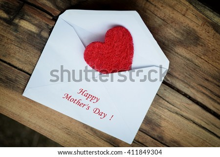 Mothers day. Mothers day card. Mothers day. Mothers day envelope with red heart. Mothers day. Mothers day background and mothers day gift. Mothers day card with copy space. Mothers day.  - stock photo
