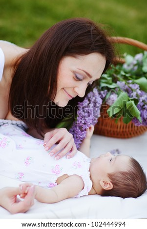 Mothers love. Summer portrait of mother and baby - stock photo