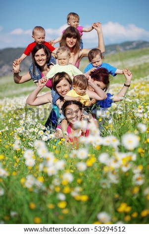 Mothers with children in flower field