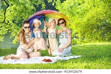 Mothers with their babies in a park - stock photo