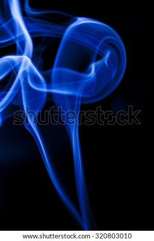 Motion blue smoke on black background.