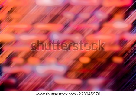 Motion blur abstract background of a brick wall in orange and pink tone