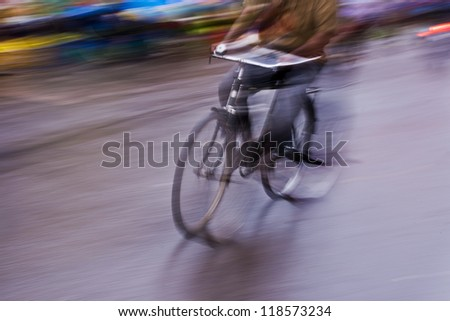 motion blur abstract of a bike rider in the street - stock photo
