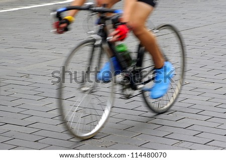 Motion blur abstract of a bike rider on the street - stock photo