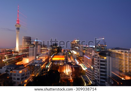 Motion blur background of Auckland financial center skyline at dusk in Auckland, New Zealand.