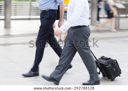 motion blur business people walking to work