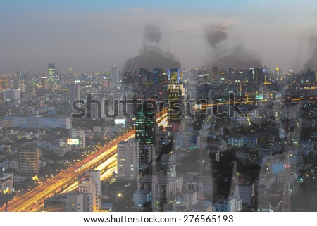 motion blur business people with cityscape background