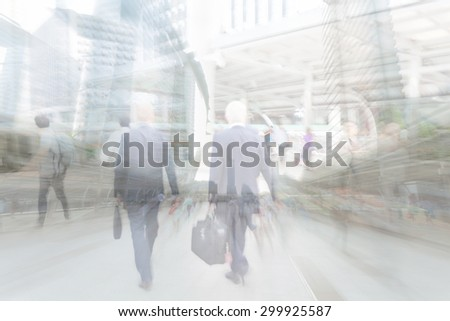motion blur businessman walking to work