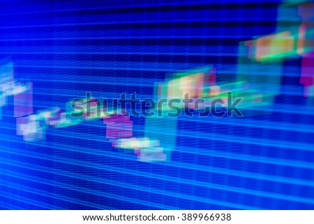 Motion blur effect. Share price candlestick chart. Financial graph on a computer monitor screen. Blue screen of finance data. Market analysis for variation report of share price.  - stock photo