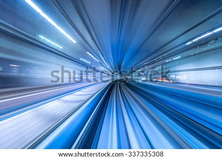 Motion blur of automated train moving in Tokyo, Japan - stock photo