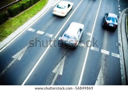 Motion blur of cars on city street - stock photo