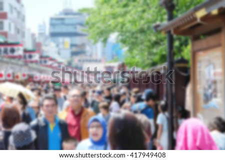 Motion blur of crowd at walkstreet for shopping in front of temple in japan - stock photo
